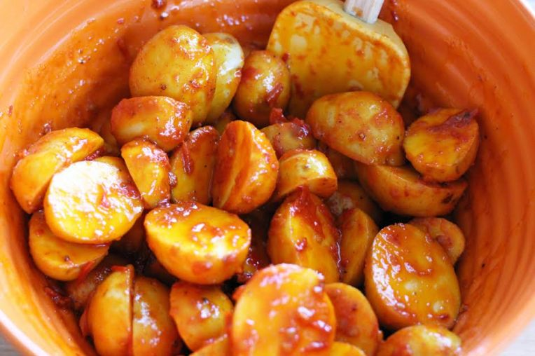 Mixing the Spicy Harissa Roasted Potatoes | artfuldishes.com