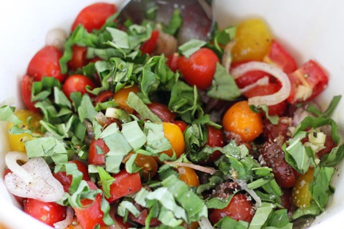Mixing the Ingredients for the Marinated Tomato Salad with Basil and Balsamic   artfuldishes.com