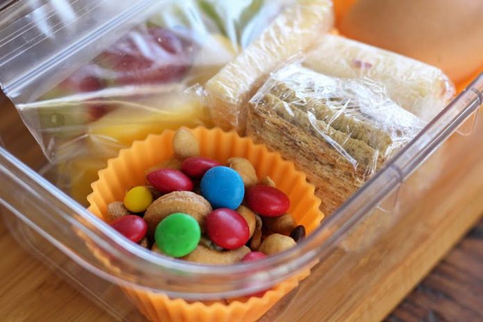 The Completed Protein Box Lunches with Fruit Nuts Cheese Crackers and Hard Boiled Egg | artfuldishes.com