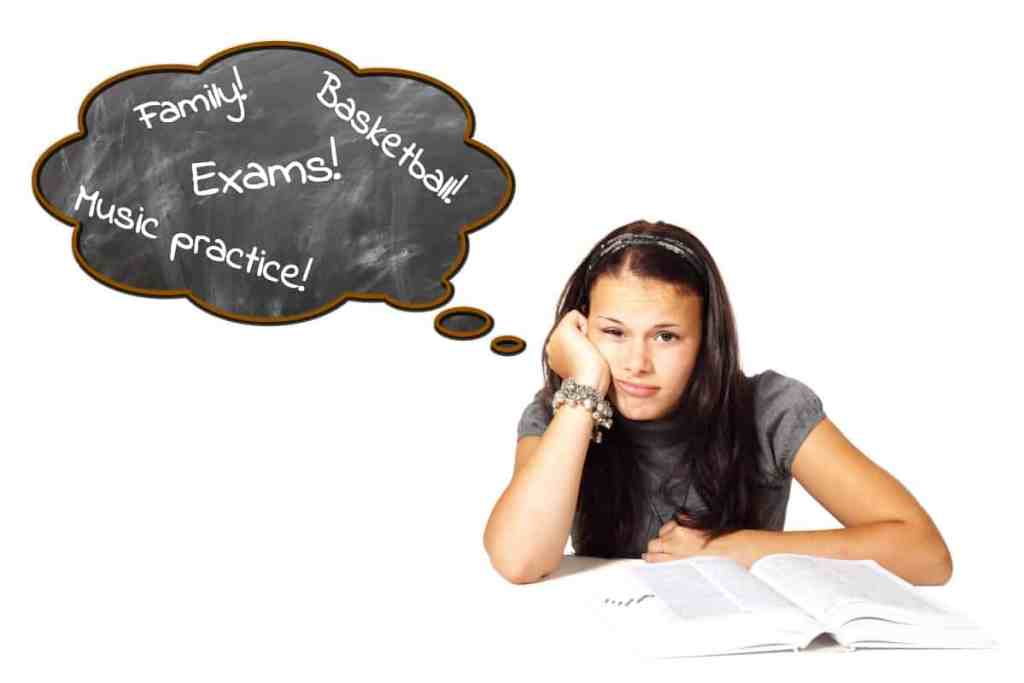 Image of stressed teen with lots on her mind - like exams, music practice, basketball, family...