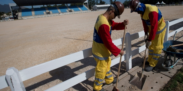 Rio de Janeiro workers clean the effected training grounds
