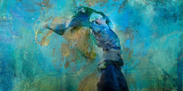 Upraised woman with colorful dress blowing on a sand dune. Moon and stars. Photo based illustration.