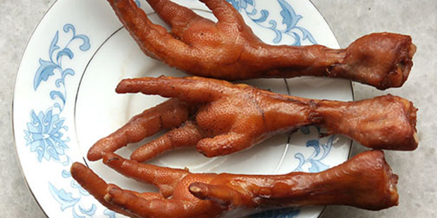 Chicken feet marinated and ready to eat. Strange delicacies from Peru.
