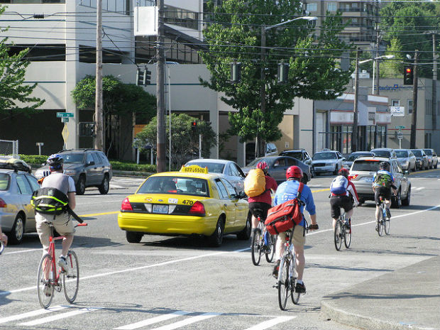 carbon neutral: bikes sharing the road with cars