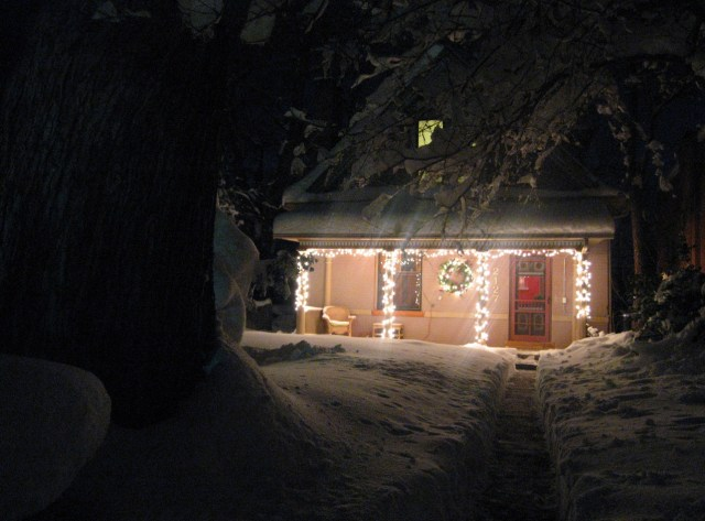 Our House Lit by Christmas Lights and Lots of Snow