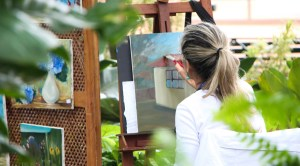 lady painting a canvas