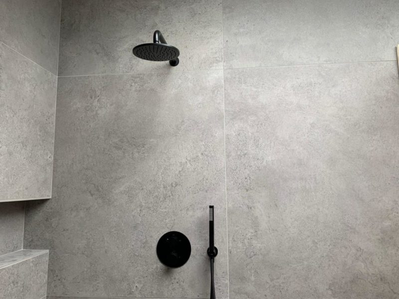 modern bathroom tiling with black showerhead