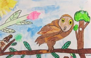First graders create bird paintings after learning about Audubon.