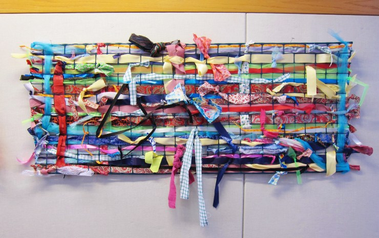 Large weaving with fabric and ribbon