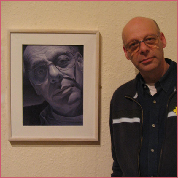 Phil Layton next to his Portrait at Welsh Portrait Exhibition