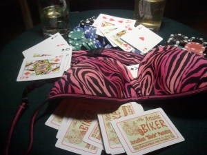 bra, playing cards, poker chips and rum