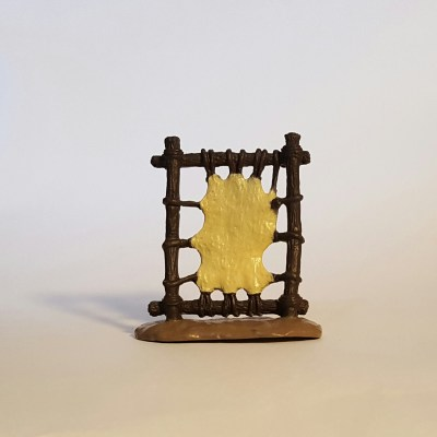 Color image of a toy model Native American leather drying rack