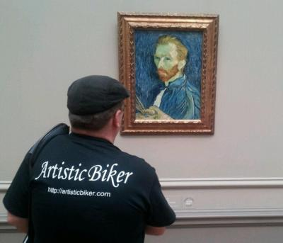 An image of me standing in front of Van Gogh's self portrait