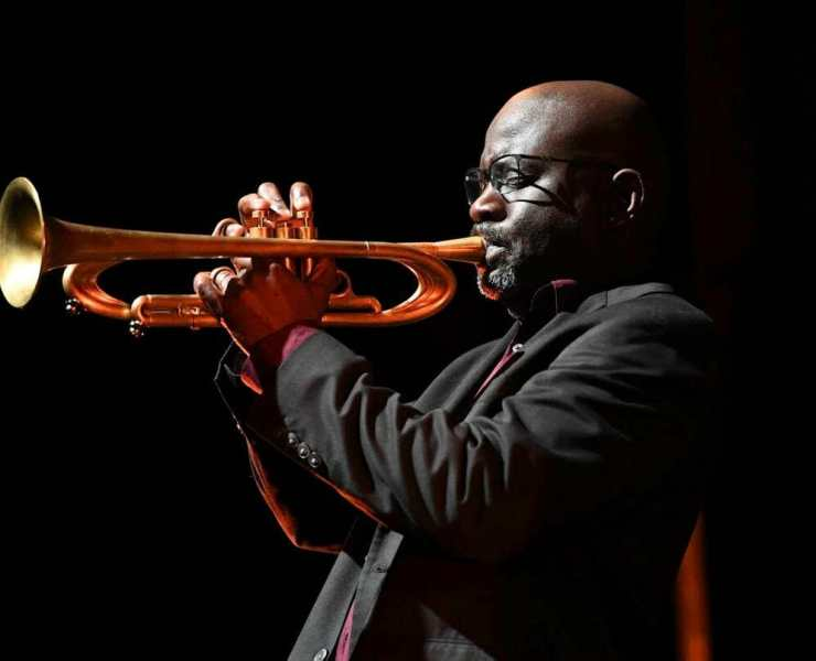 Charlton Singleton playing trumpet