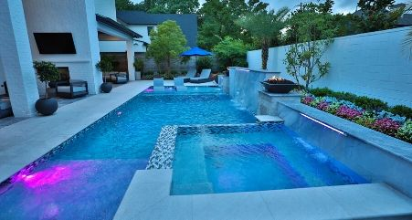 Modern geometric pool with clean lines and zoned areas.