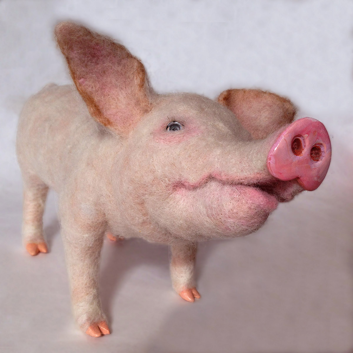 Laura Lee Burch Needle Felted pig looking up.