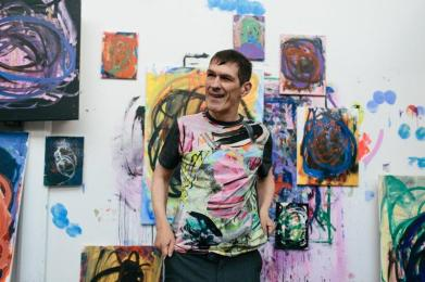 George wearing the T shirt made from his paintings