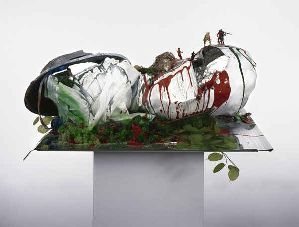 Isa Genzken, Empire/Vampire I, 2003, paint on mirror foil, fabric, plastic figures, and artificial plants on wood pedestal.  ©ISA GENZKEN. COURTESY COLLECTION MARI AND PETER SHAW, THE ARTIST AND GALERIE BUCHHOLZ, COLOGNE/BERLIN.