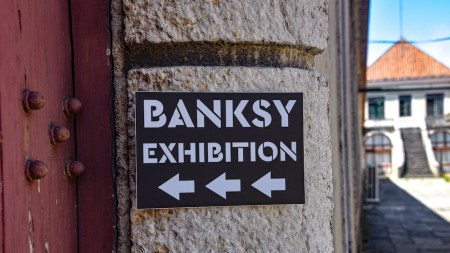 A sign for the Banksy exhibition