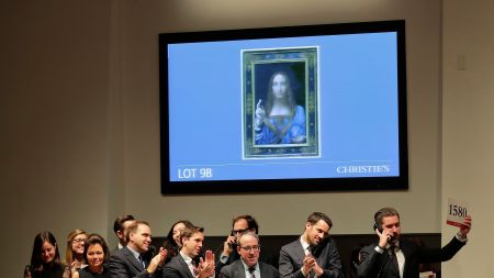 Bidding representatives react after Leonardo da