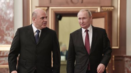 Mikhail Mishustin (at left), Russia's Prime