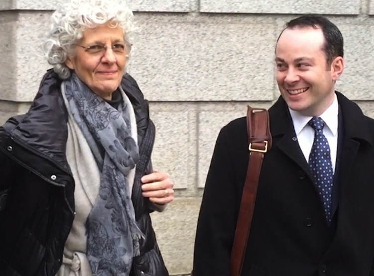 Ann Freedman with her lawyer Luke Nikas outside a courthouse.