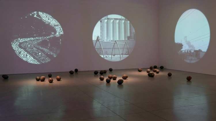 Maru García, Vacuoles: Bioremediating cultures , (2019). Installation with 29 ceramic pieces containing lead-contaminated soil from South East LA and three-channel video projections. Part of a PST research project being undertaken at Self-Help Graphics & Art.