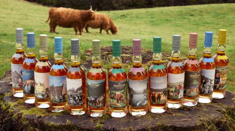 The 13 Anecdotes of Ages Collection bottles, a collaboration between Sir Peter Blake and The Macallan. The 13 one-of-a-kind hand-blown bottles with oak stoppers, photographed in a field.