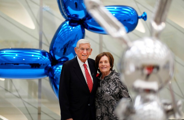 Eli and Edythe Broad with a work by Jeff Koons.