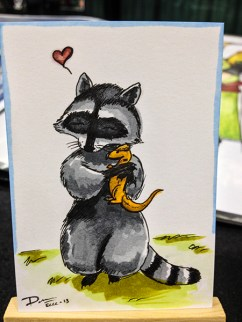 Racoon and stuffed Dino
