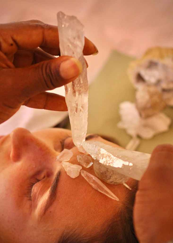crop ethnic master transferring crystal energy to female client