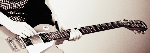 Music-man-playing-electric-guitar-modified1-e1412632283673