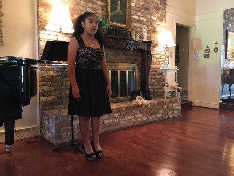An Arts District Chorale Apprentice during the Apprentice Program recital.