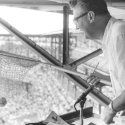 Harry Caray catches a foul ball in a net