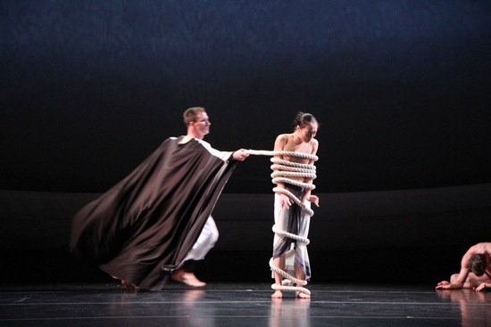 Ben Schultz as the Shaman binds Xiaochuan Xie as the Chosen One. Photo: Charles Eilber, courtesy of the Martha Graham Dance Company