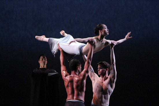 Martha Graham's Rite of Spring. Abdiel Jacobsen (L) and Lloyd Mayor lift Xiaochuan Xie as the Chosen One. The Shaman (Ben Schultz) watches. Photo: Charles Eilber, courtesy of the Martha Graham Dance Company.