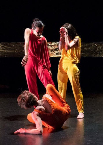 Aretha Aoki (in red), Emily Johnson (in yellow), and Krista Langberg (in orange) in Johnson's Shore. Photo: Ian Douglas
