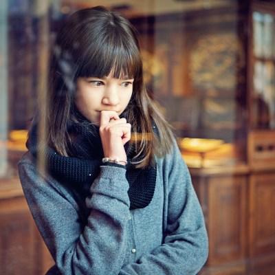 Teenage girl is looking museum exhibition