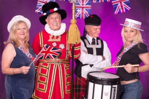 Getting into mood for Last Night of the Proms are British Cultural and Heritage Association colleagues Lynne Cook and Cheri Steenberg with Dave Burch of the Durban Symphonic Choir and drummer Corrie Stevens of the Durban Regiment. Photo: Val Adamson.