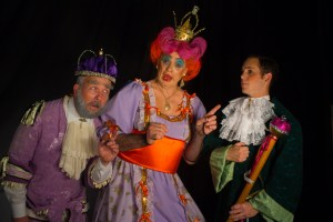Mark Farrow plays King Wally, with Leslie Speyers as the dame, Queen Wendolina, and Matthew Hamilton as the Page, Bobbie, in Puss in Boots, the end-of-year Pemads pantomime at the Little Theatre from Thursday, December 1. Photo: Simone Jeffrey