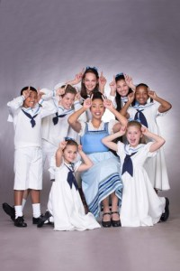 Lynelle Kenned as Maria with the seven Von Trapp children.