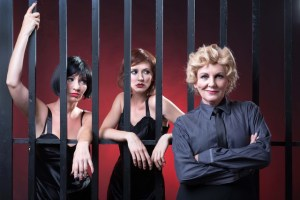Chicago - Two murderesses: Showgirl, Velma Kelly (Katy Moore); housewife, Roxie Hart (Jessica Sole) with Mama Morton (Charon Williams Ros) - Photo: Val Adamson Photography.