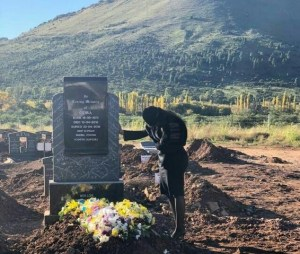 Odwa's widow (Tebogo) at his graveside in the Eastern Cape