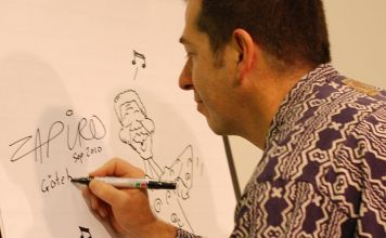 Zapiro drafts a cartoon of Nelson Mandela at the Göteborg Book Fair 2010. (Photo: Bengt Oberger)