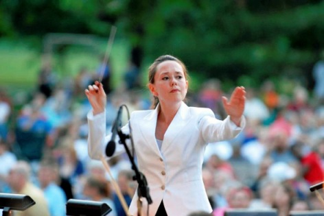 National Symphony Associate Conductor, Kelly Corcoran leading 2013 summer concert at Centennial Park. Photo by Harry Butler