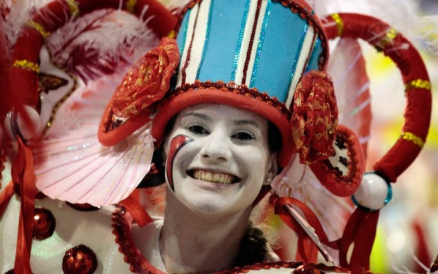 A reveller looks on while dancing on a float of the Inocentes de Belford Roxo samba school on the first night of the annual carnival parade in Rio de Janeiro's Sambadrome