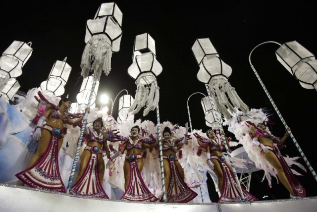 Revellers dance on a float of the Inocentes de Belford Roxo samba school on the first night of the annual carnival parade in Rio de Janeiro's Sambadrome