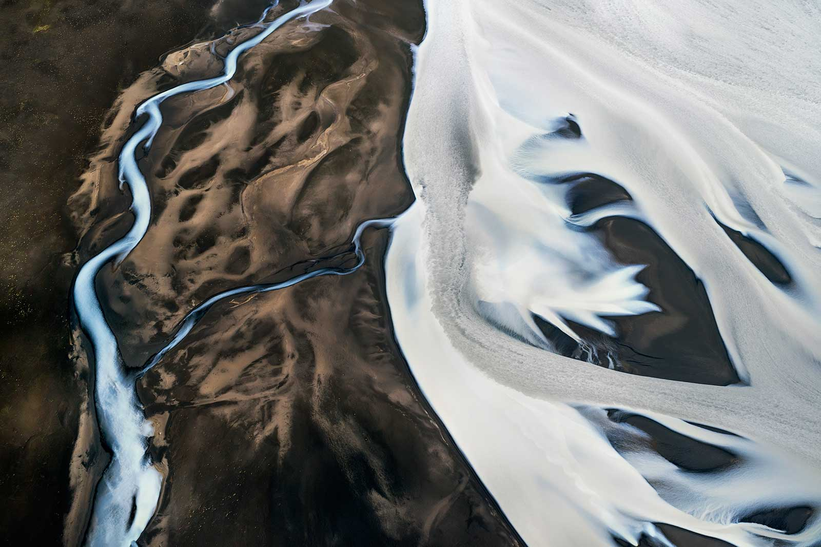 aerial view of landscape of ice and volcanic soil