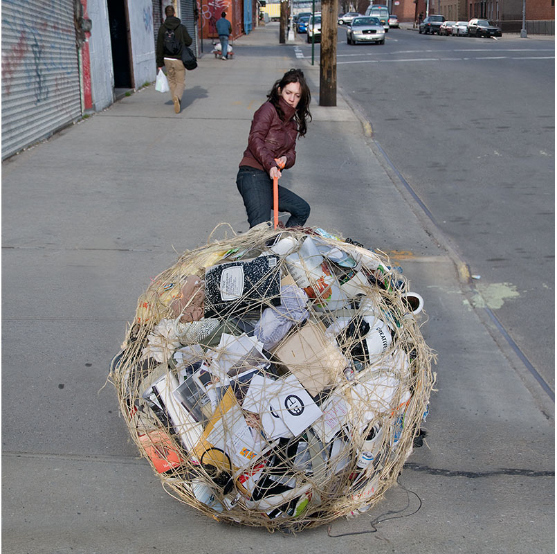 woman pulling ball of possessions