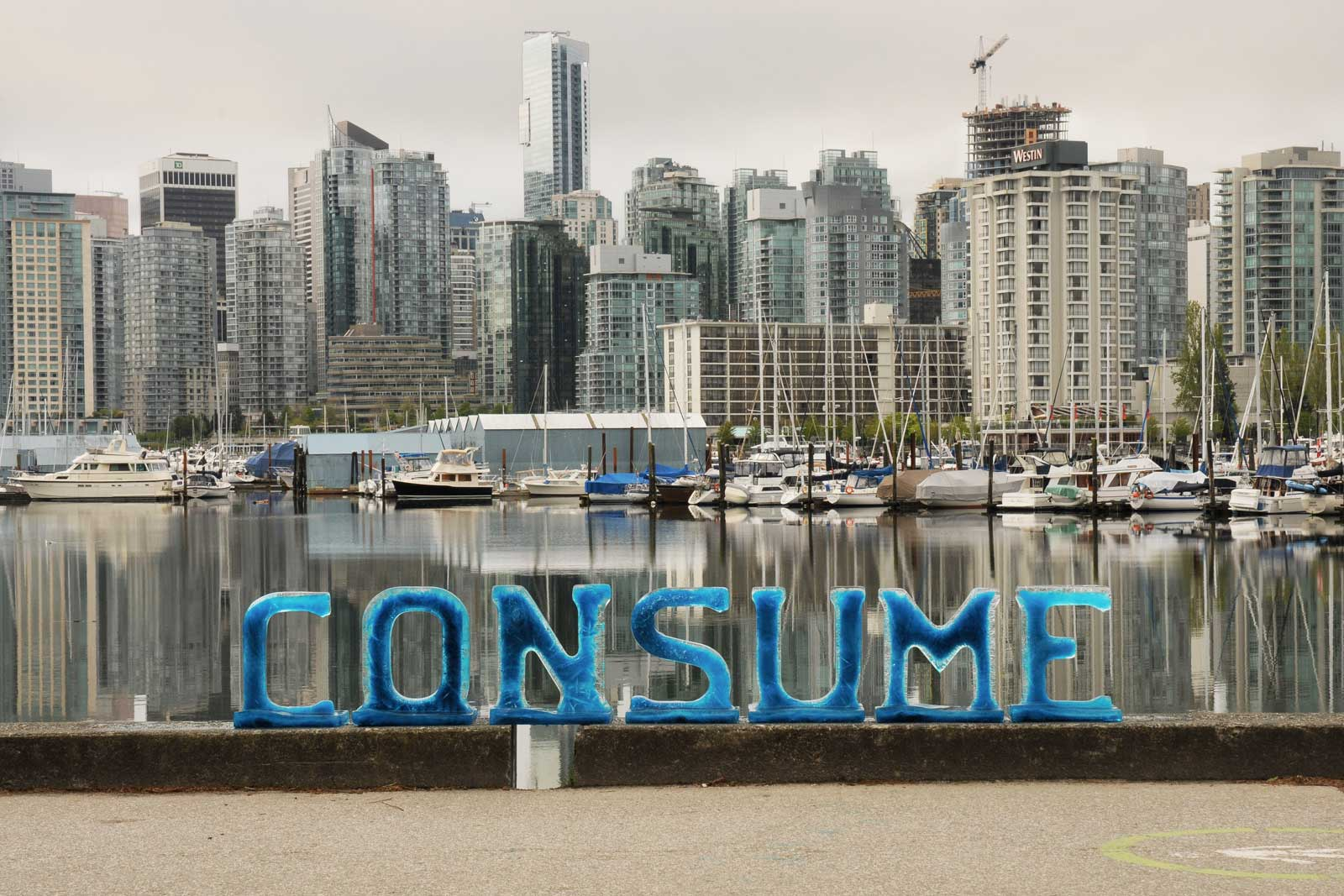 CONSUME spelled with ice letters with city in background